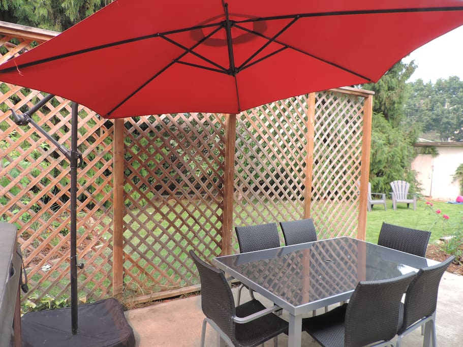 The patio area by the hot tub is the perfect place for outdoor relaxation and BBQ's
