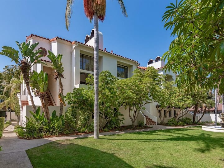 Upscale West beach Townhome with solar heated pool