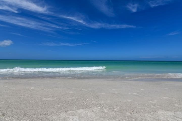 White sands and blue waters of Anna Maria Island.
