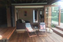 Tia the dog and you back deck complete with deck chairs for relaxing