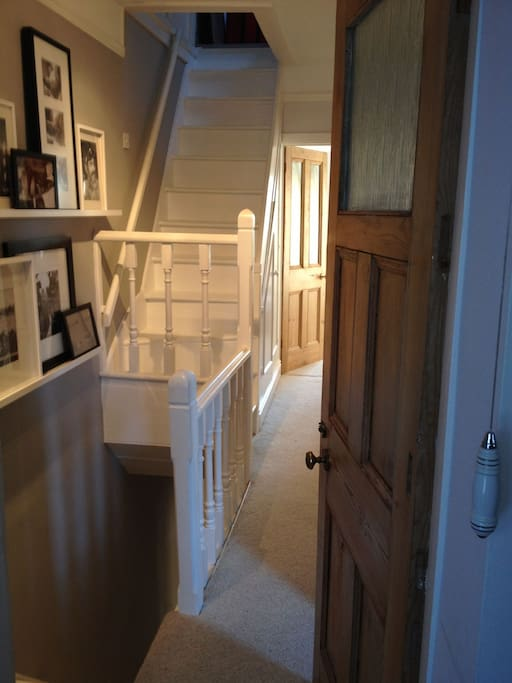 This is the landing on the 1st floor with the stairs on the left hand side leading up to your attic bedroom.
