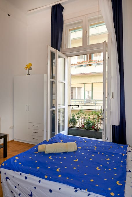 the bed with the balcony