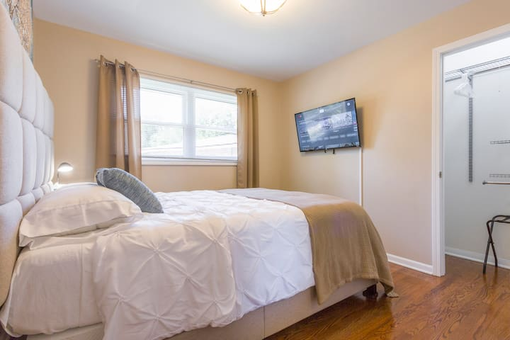 Bedroom #1. Queen size bed. The TV is a ROKU TV and has complimentary Youtube TV ready for you to enjoy.  You only need the single ROKU remote to control everything on the TV. Hangers and Luggage Racks are in each bedroom closet.