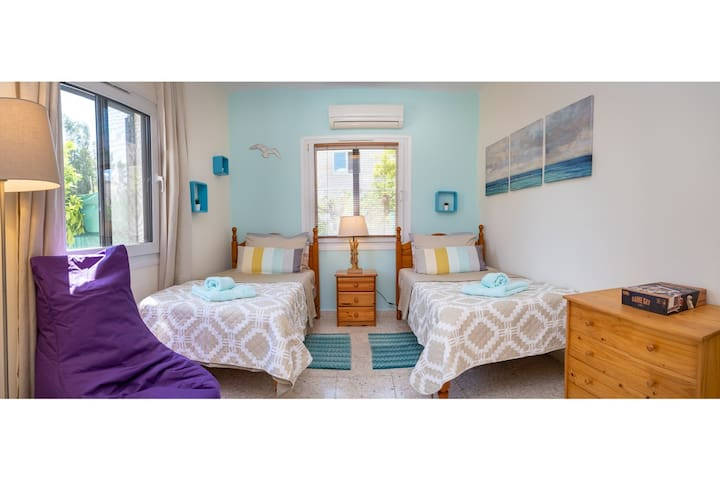 Second bedroom with twin beds. All windows have curtains/blinds and external blackout/safety blinds. Bedlinen and towels are provided. Full air-conditioning.