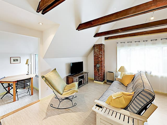 Wood accents highlight a light and airy atmosphere throughout the apartment.