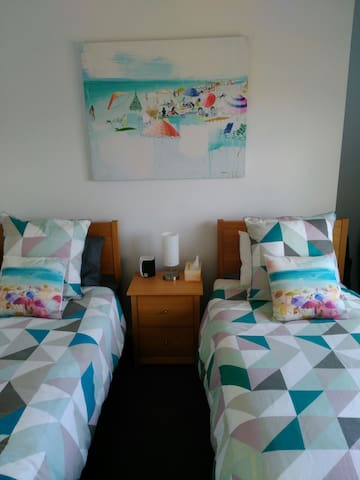 Second bedroom featuring 2 king single beds that can be joined to form a king size double bed.