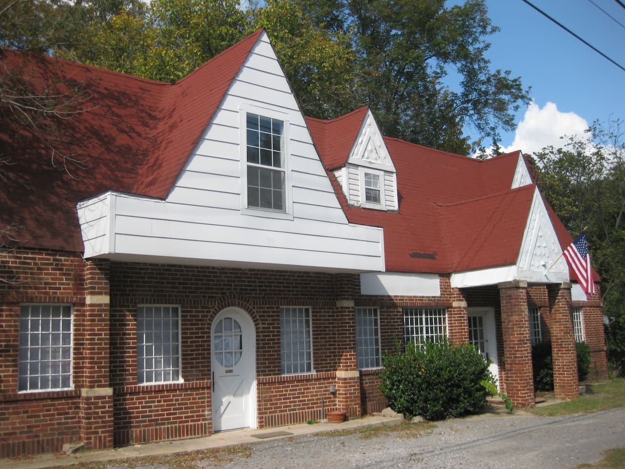 Unique studio apartment in historic building. (Note: Apartment located under large dormer. Round top door.)