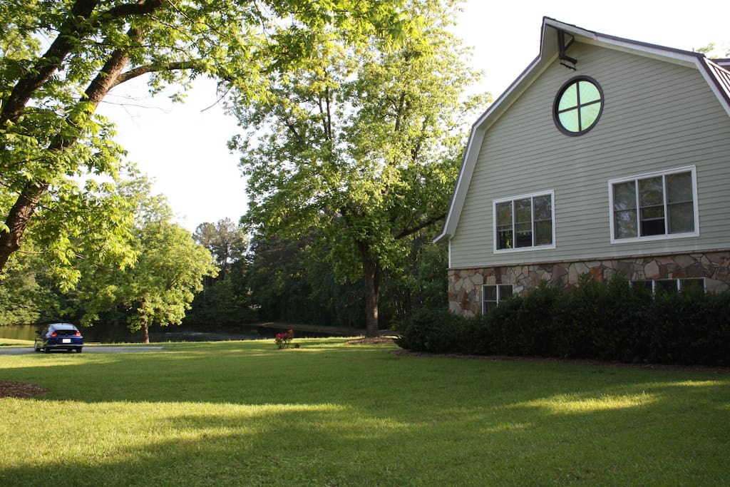 View of side of home facing towards driveway and pond.