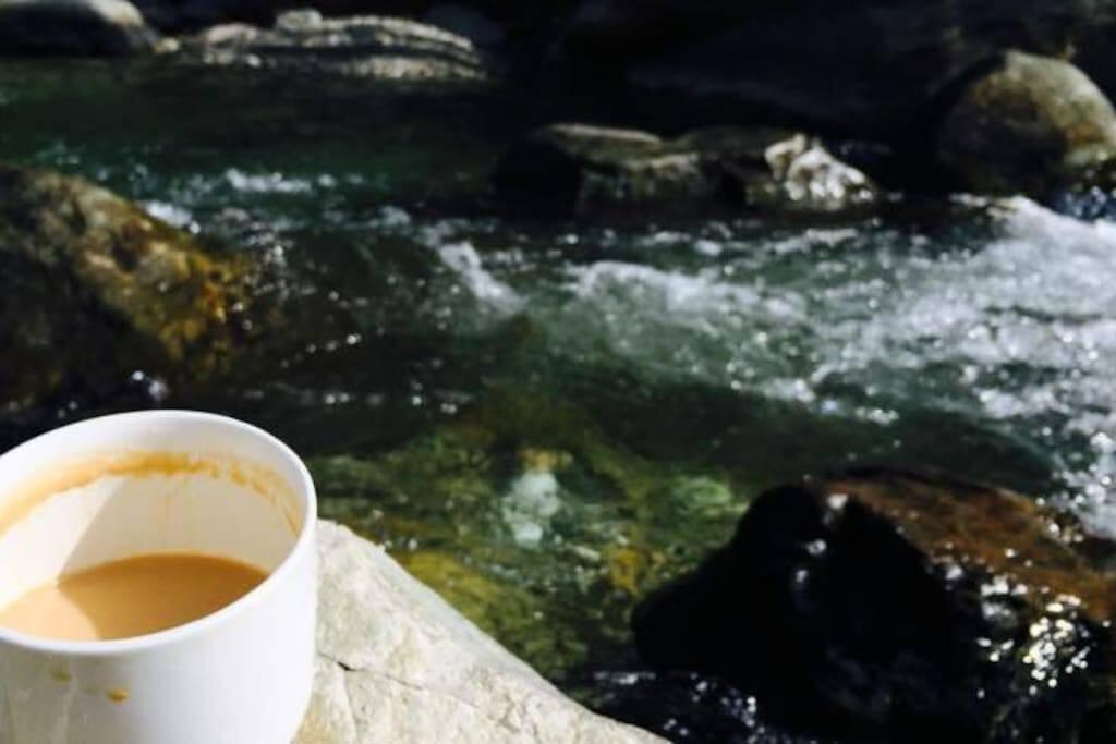 Enjoy your favorite beverage beside the river.
