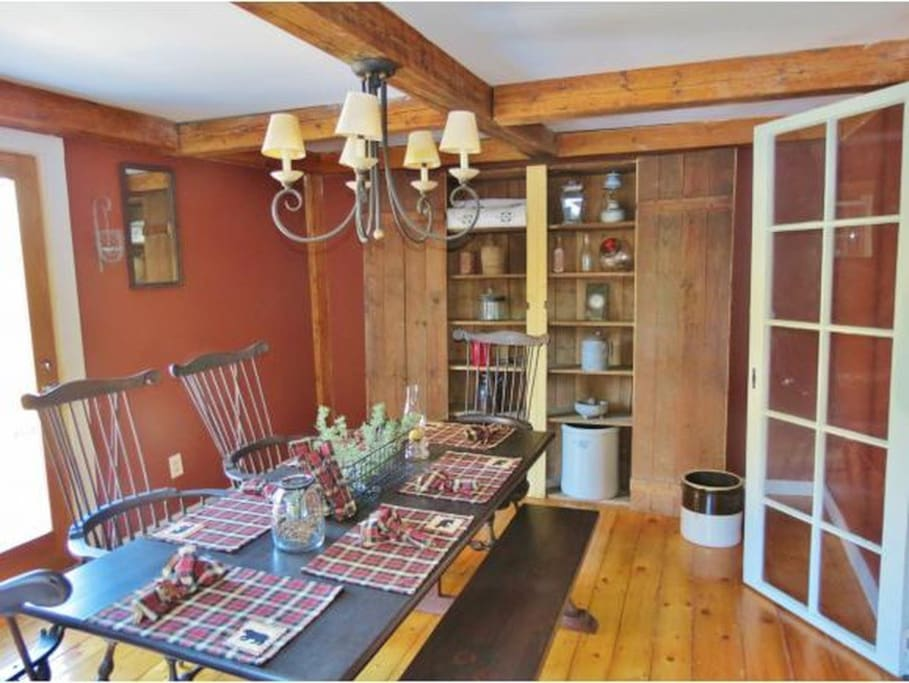 Cozy Vermont style country home. This dining room is great for entertaining. There's also a sliding door entrance to the back porch for great views of the green mountains.