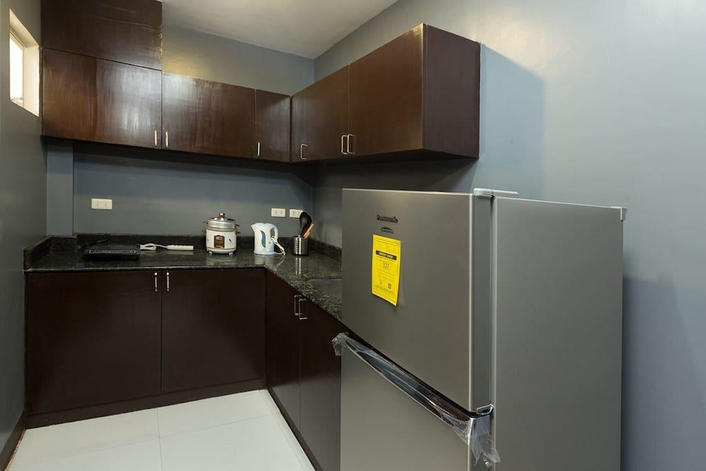 Kitchen with various usable kitchen appliances