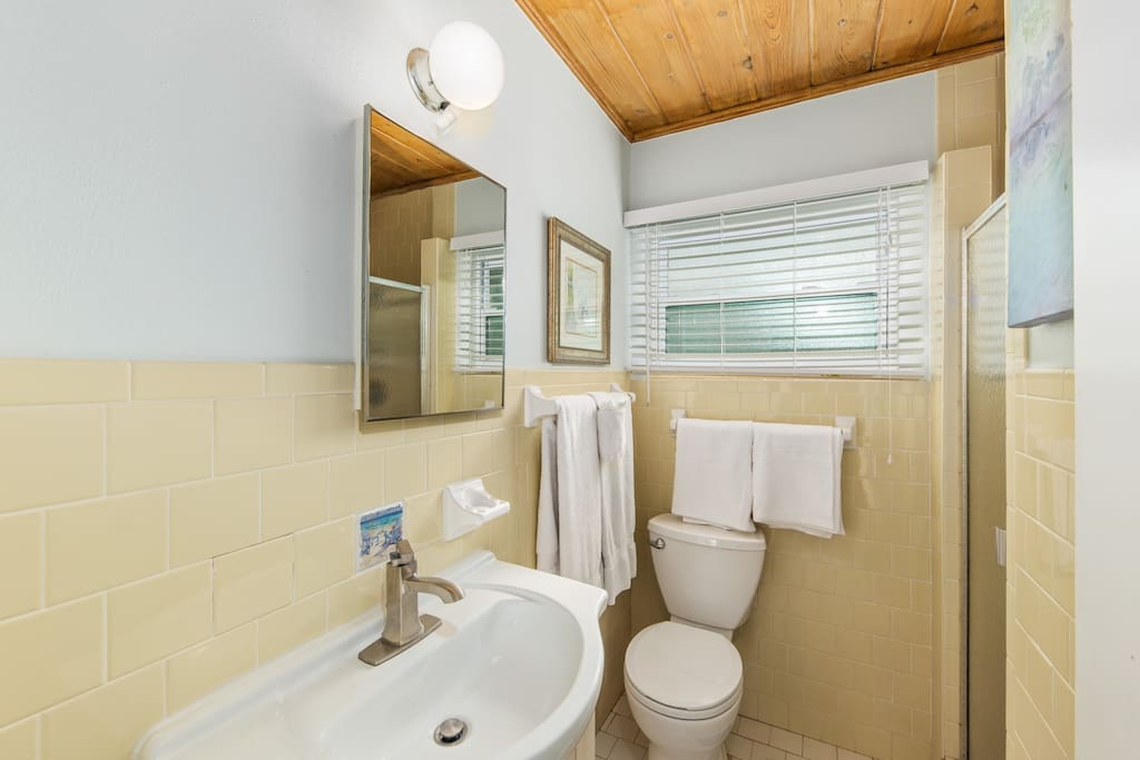 Renovated Bathrooms with New Toilet, Vanity, and Tile