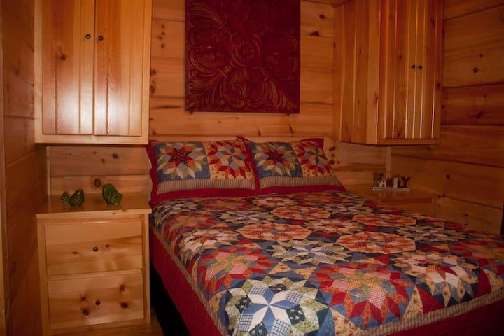 Queen bed with plenty of storage.