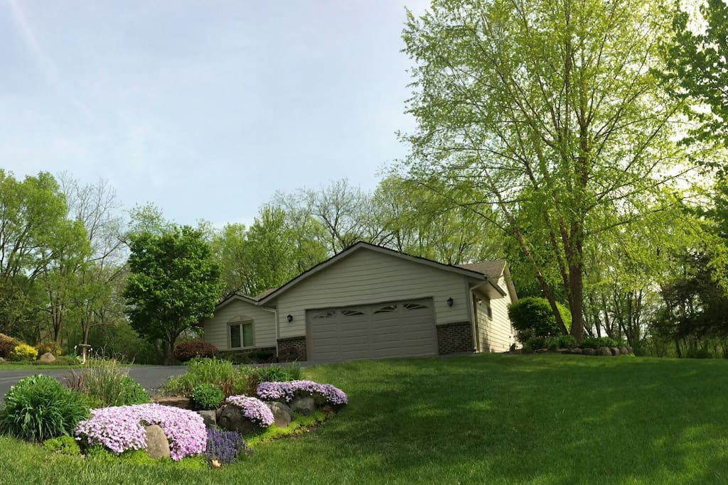 Street view, ample parking. Boulder landscaping, river birch tree, lilac tree