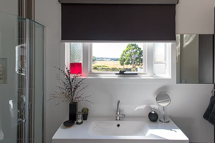 Enjoy the view (or morning sunrise if you're up early enough!) from the master bedroom ensuite.