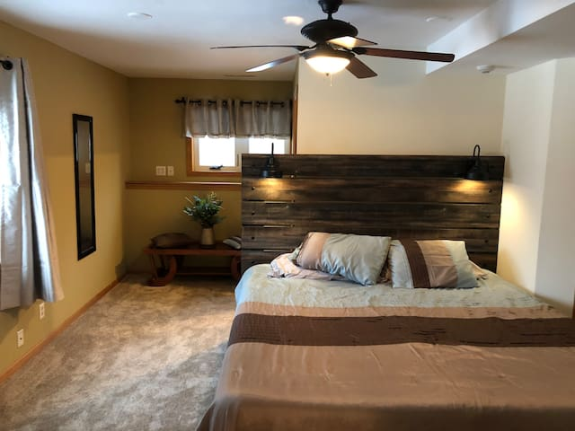 King Size Bed with Tempur Pedic mattress and soothing reading lights.