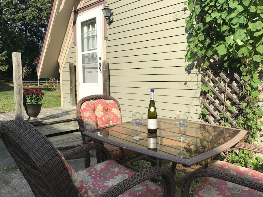 Enjoy a cup of coffee or glass of wine on the apartment patio overlooking our garden!