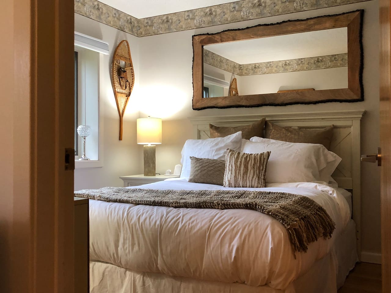 Newly renovated bedroom. Includes dresser, room darkening, easy open shade, 2 large windows, closet, and smaller secondary TV.