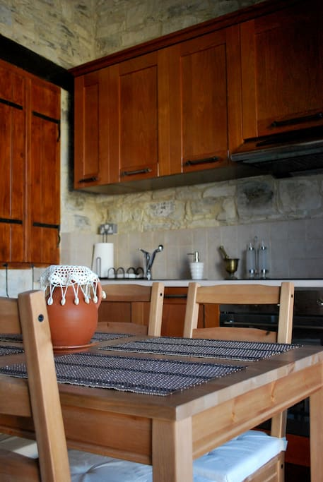 A view of the kitchen and dining area, which have a unique view of the courtyard.