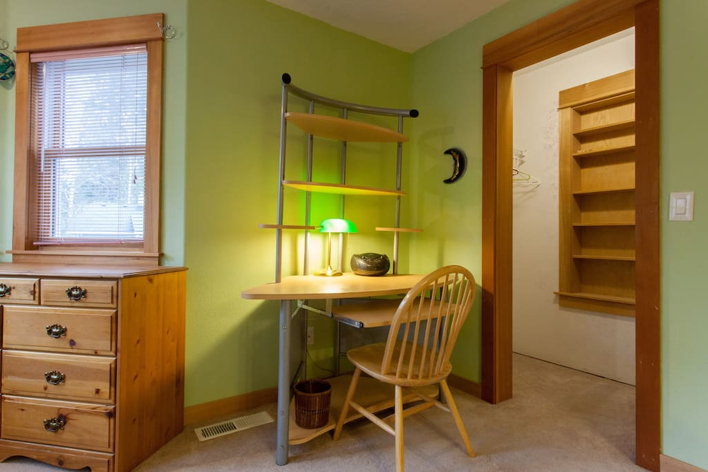 Desk and closet in bedroom.