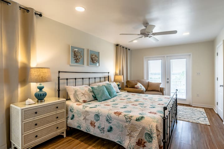 King master suite has a great view of the beautiful lagoon.