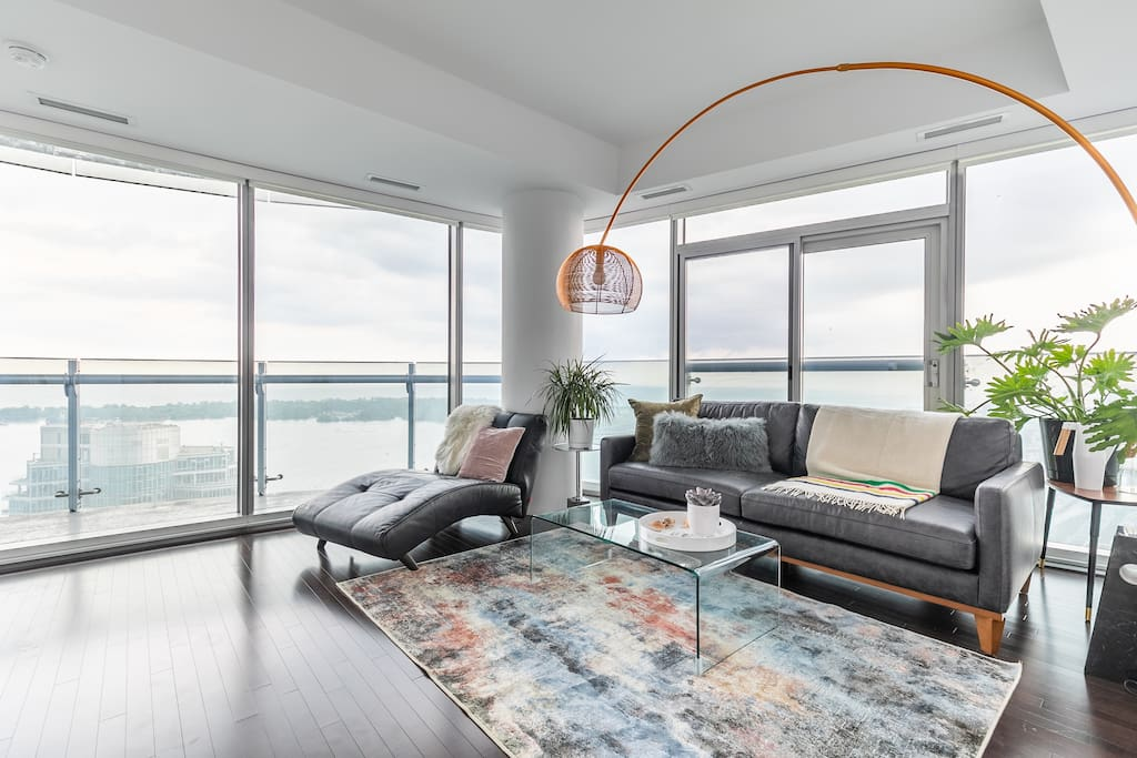 Beautiful corner suite overlooking the lake, Toronto island and CN Tower, this luxury suite is everything but a typical high-rise condo