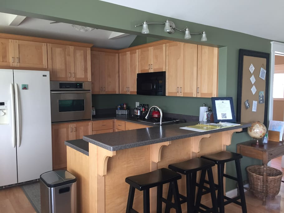 Custom maple cabinetry & Corian and kitchen. Fully equipped to host gatherings with a spectacular panoramic view of Waubee Lake.