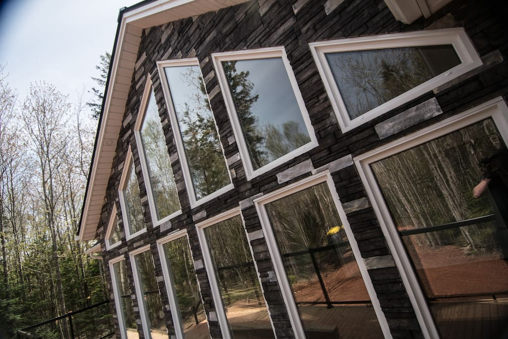 You'll enjoy forest views through our gorgeous window wall!