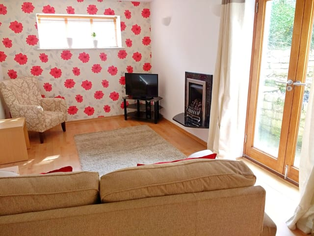 Comfy living room with real flame gas fire, TV, DVD player, and free wifi.