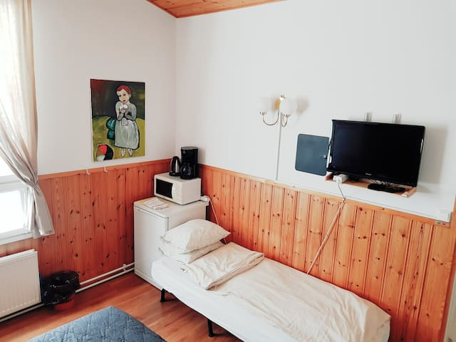 With open sofa bed for the third person