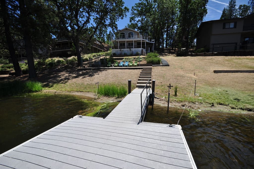 "Backyard, private dock + lakeside patio. ""Sierra Lakeshore Escape"". Unit 4 Lot 109. Pine Mountain Lake, Lakefront Vacation Rental by Yosemite Region Resorts."