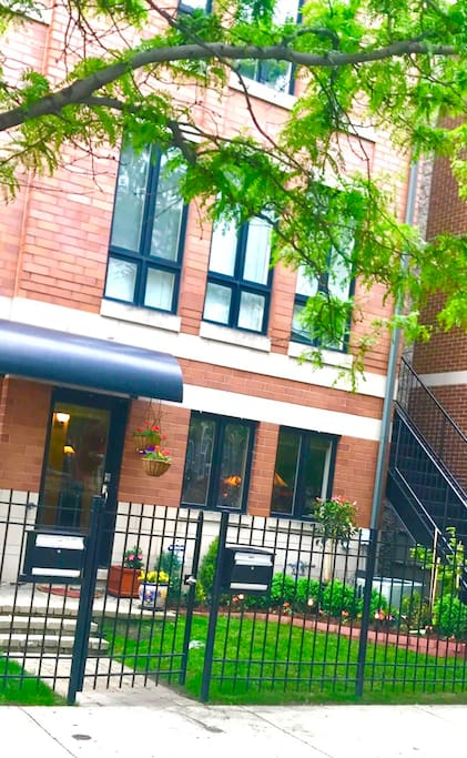 Four story townhouse in Chicago. Walk to the Cubs game. Includes attached garage.