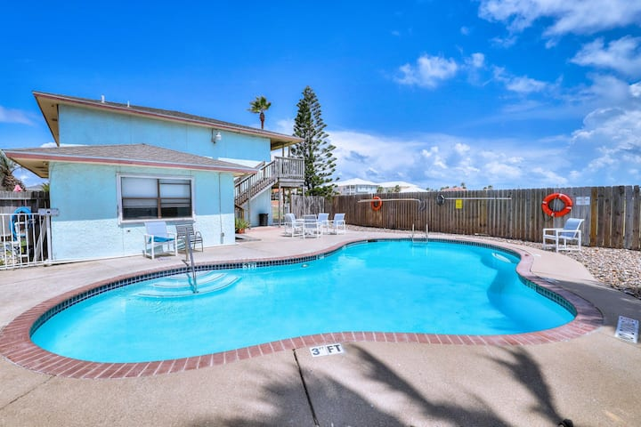 Canal front condo close to beach w/shared outdoor pool, pier, & patio, free WiFi