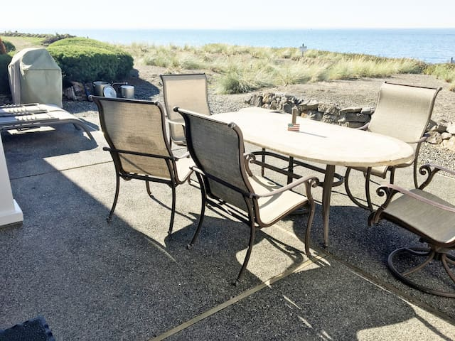 Another angle of Ocean Front Patio. BBQ, 2 Chaise Loungers, Table, Chairs