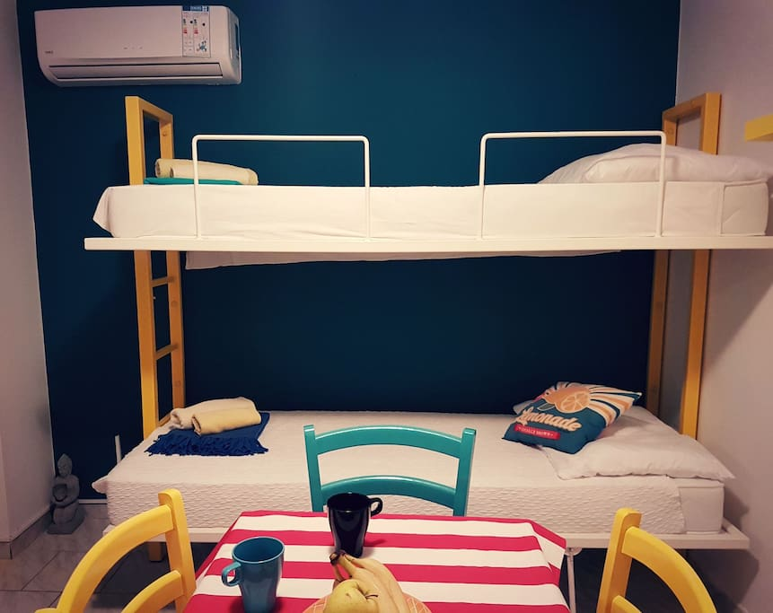 Custom made bunk bed from steel with new comfy mattresses.