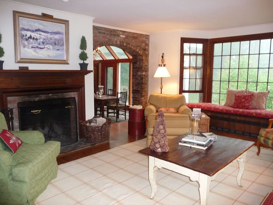 Living area with fireplace and  game table