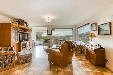 Beautiful home with ocean and beach views, wood-burning stove & firepit!