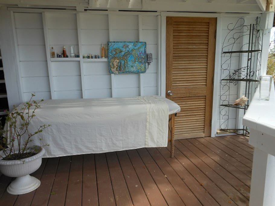 Massage room, garden and sitting room are part of the suite (bathroom door to right of table)