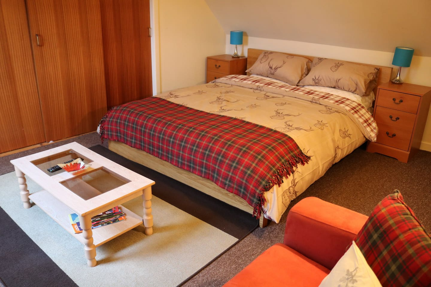 Large queen size bed with additional convenient sofa bed.