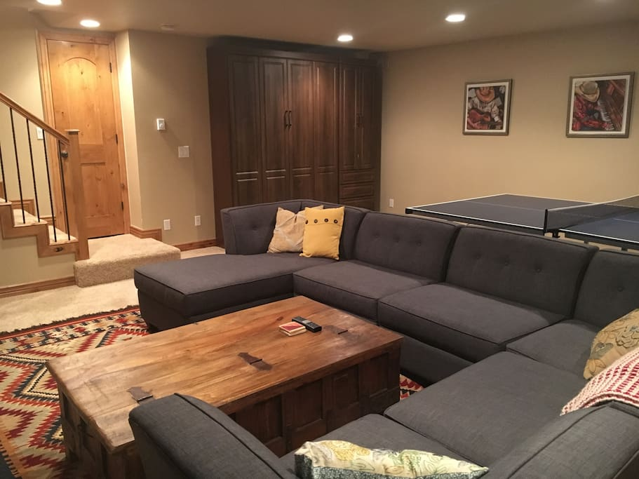 Family room/basement (notice custom built murphy bed built into wall). Queen bed with great mattress and closet space
