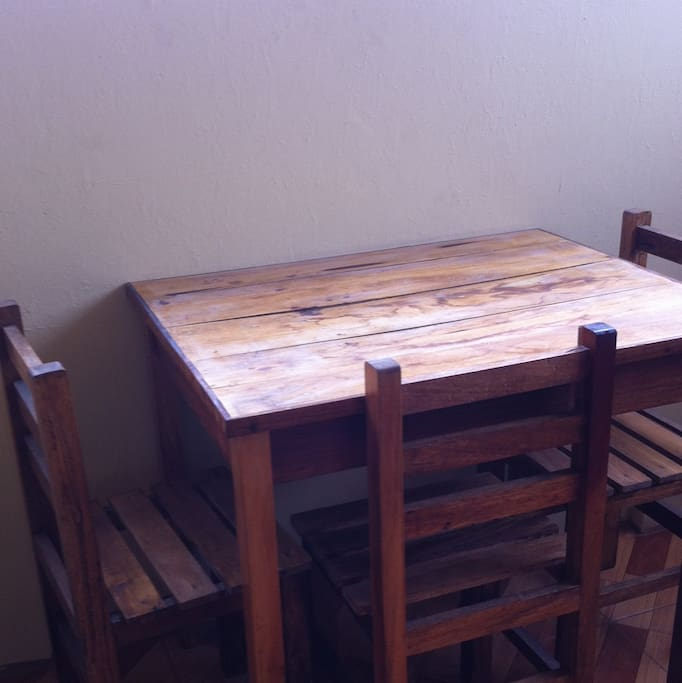 wood table and chairs for eating or laptops or luggage
