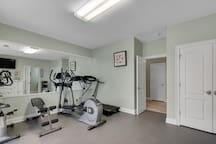 Convenient private gym with weight bench and dumbell set; eliptical; and treadmill.   Rubber matted floor for yoga and pilates.