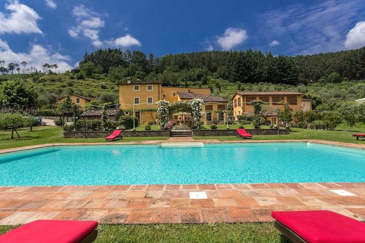 Traditional Tuscan Villa Surrounded By Olive Groves And Orchards