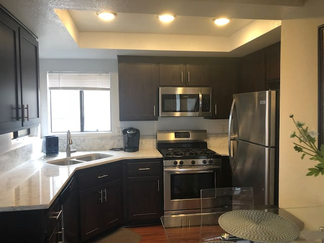 Newly remodeled kitchen with all new stainless steel appliances with keurig coffee maker