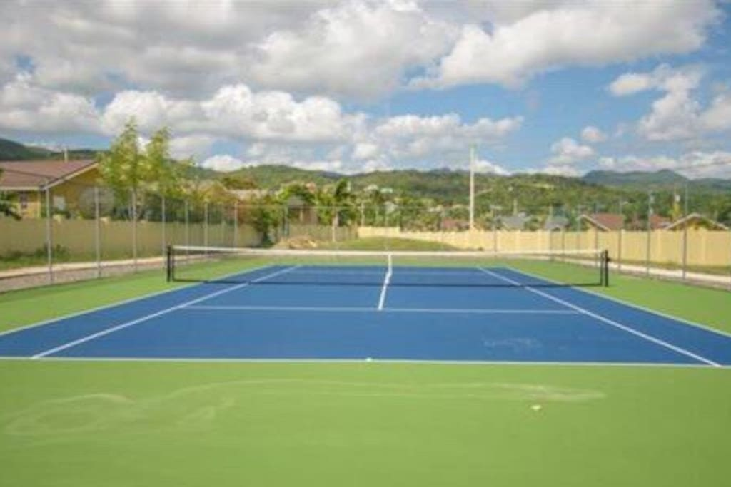 Tennis court with jogging path