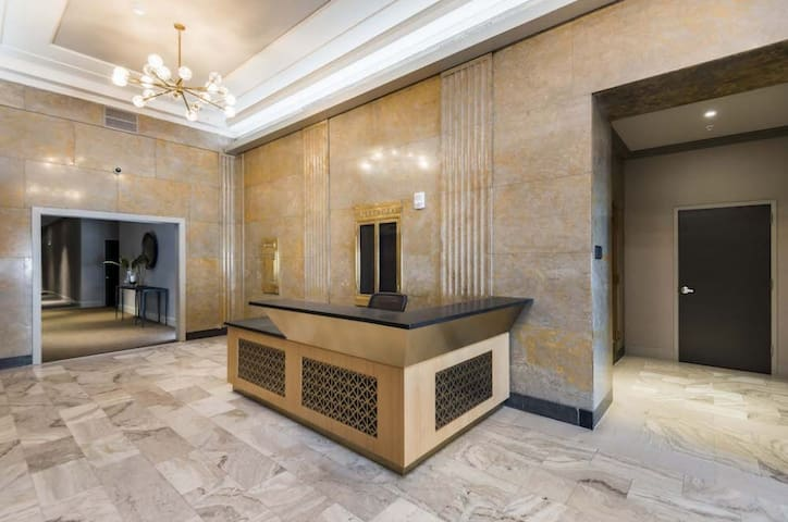 Marble lobby with over night security