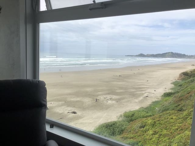 View looking out the loft's north window, at the Yaquina Head Lighthouse. Upper part of the  window opens and has a room darkening blind.