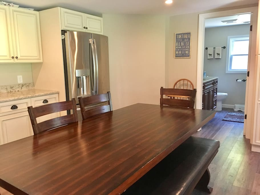 Comfortable kitchen seating for dining and playing games with the family. Seats up to 8 people.