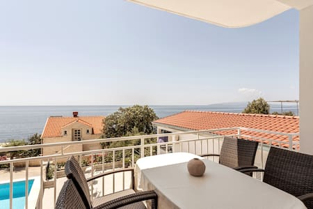 Steps away from a beach - apartment for 4