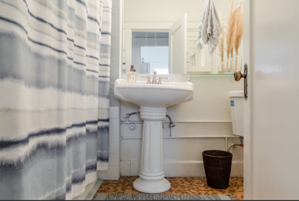 Fully renovated bathroom with quaint decor touches.